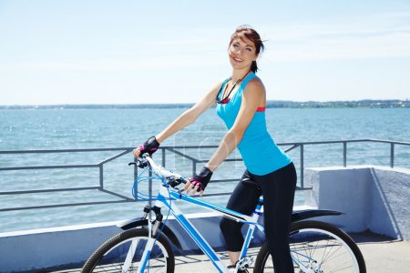 Photo for Young woman with a bike outdoors. Active people outdoors. sport lifestyle - Royalty Free Image