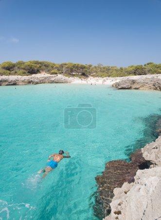 Snorkeling in a beautiful cala in Minorca.
