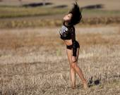 Barefoot sexy woman feeling wind in her hair.