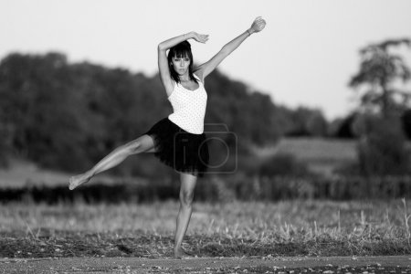 Gymnast on a country road at the first sunlights.