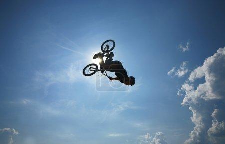 Back-flip against blue sky