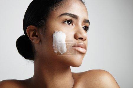 latin woman with foam on cheek