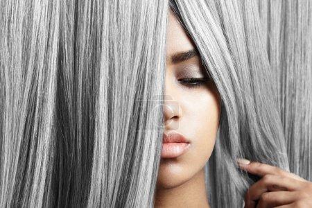 woman looking through grey hair
