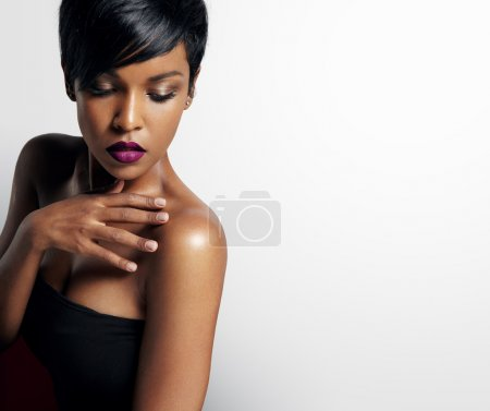 Beautiful black woman with purple lips on white ba...