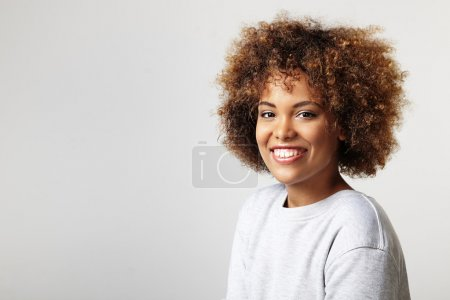 Portrait of latin woman with curly hair wearing sw...