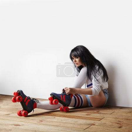 Woman putting roller-skates