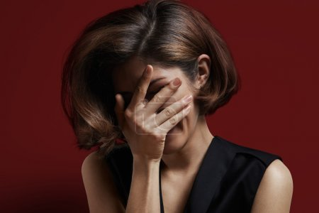 Woman cover face with hand