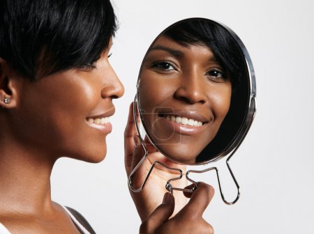 Black woman with mirror