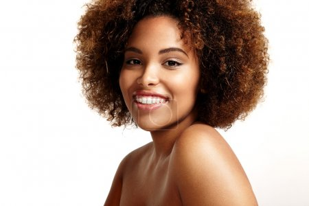woman with afro hair style smiling