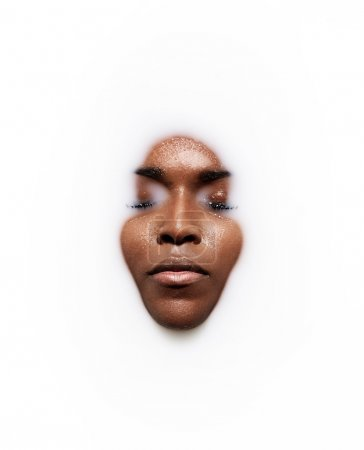 Photo for Black woman's face in a milk. - Royalty Free Image