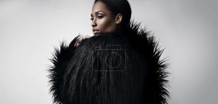 woman wearing faux fur jacket