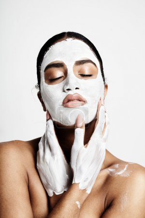 woman with clay facial mask