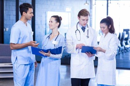 Doctors looking at medical report