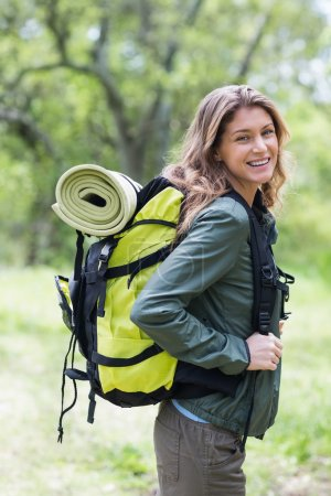woman standing with backpack