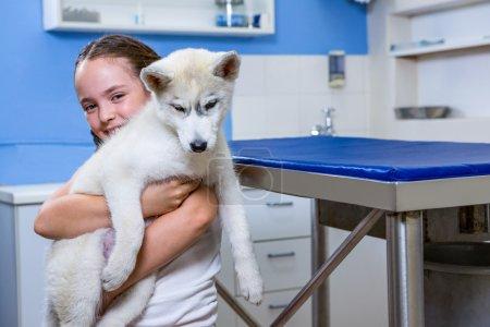 A little girl bringing a dog