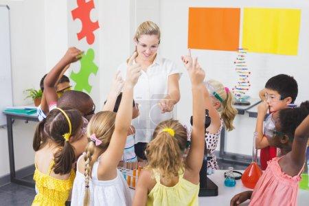 Kids raising hand in laboratory