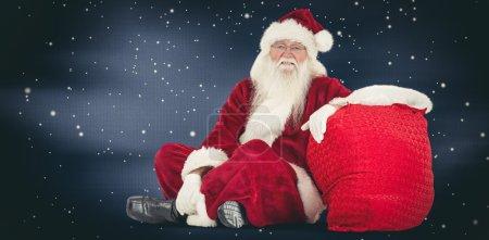 santa sits next to his bag