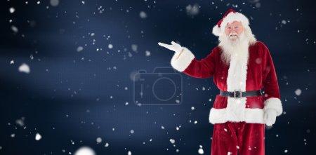 santa shows something to camera