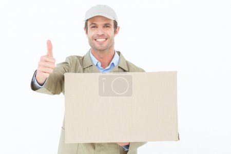 Delivery man gesturing thumbs up