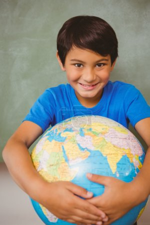 Cute little boy holding globe