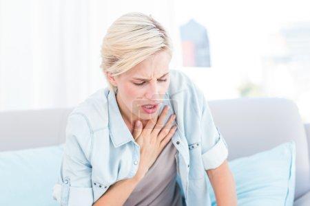 blonde woman having breath difficulties