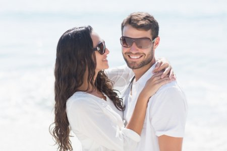 couple smiling at the beach