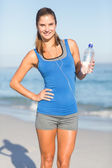 Beautiful fit woman holding water bottle
