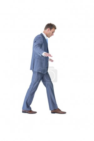 Businessman walking in equilibrium