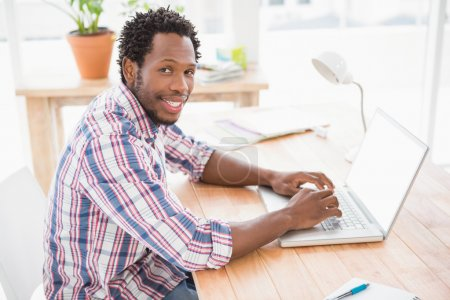 businessman in front of laptop