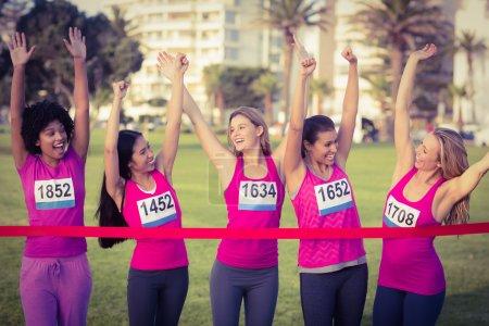 Cheering women supporting marathon
