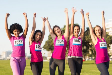 women supporting breast cancer marathon