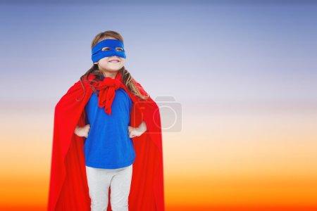 masked girl pretending to be superhero