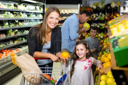 family choosing groceries together