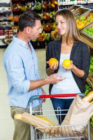 couple choosing groceries together