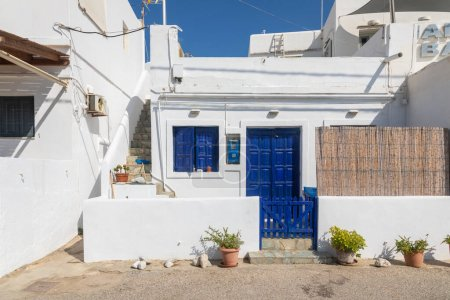 Photo for Folegandros Island, Greece - 24 September 2020: Characteristic Greek buildings in the center small, port town. - Royalty Free Image