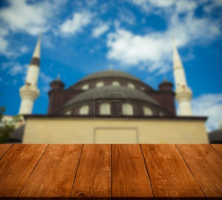 View of Hagia Sophia over old wooden table or board. Collage. Se
