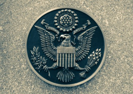 Bronze seal of the United States on marble. toning
