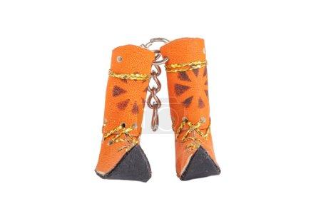 Keychain Yakut boots isolated on white background