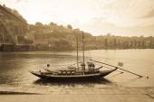 Boat with barrels of wine at the berth. Douro River. city of Por