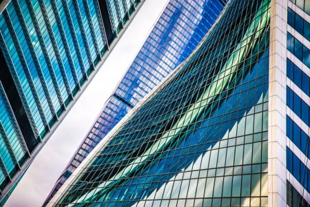 Glass walls of the building Moscow City with reflections. A lot
