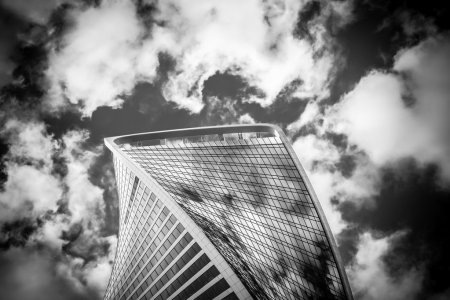 The top of one building of business complex Moscow City in cloud