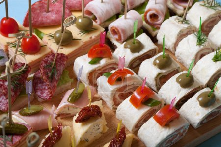 Different kinds of snacks canape on skewers. Selective focus