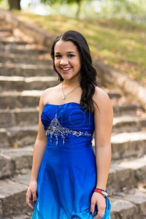 Photo for Teen girl wearing her formal Quinceanera dress - Royalty Free Image
