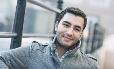 Photo for Happy young man, outdoor - outside. Close up of gorgeous male in coat, coldly morning - Royalty Free Image