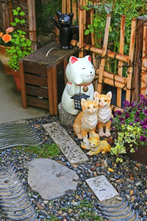 Japanese ceramic cats as lucky charm to decorate the zen styled