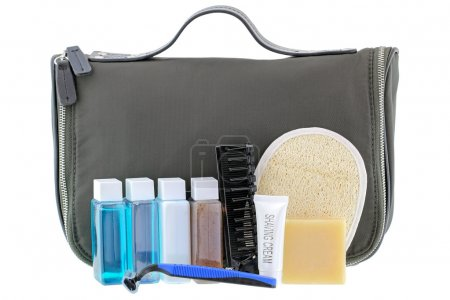 Photo for Black traveling cosmetic bag with toiletries in the front, isolated on white - Royalty Free Image