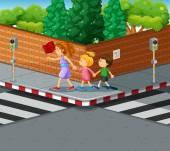 Woman helping kids crossing the street