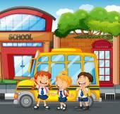 Studenti a školní autobus na škole