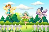 Three fairies flying in garden