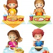 Children eating food on the dining table...